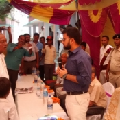 A discussion among a child, Mukhiya (Panchayat Head) and DC for the absence of toilet in the child's home