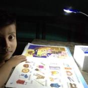 Raj with the solar lamp